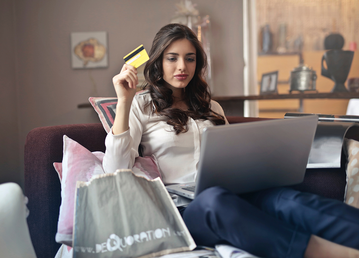 Woman checking her credit card score on a laptop